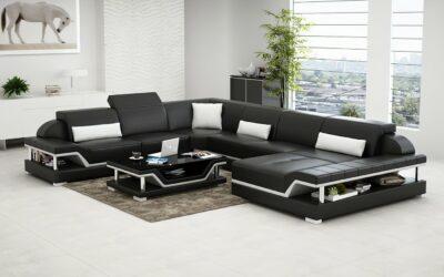 Pernilla design U-soffa i äkta skinn - Svart med vita detaljer